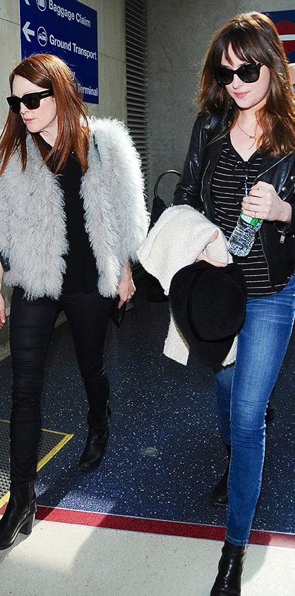 Dakota Johnson and Julianne Moore arrive in LA on the same flight