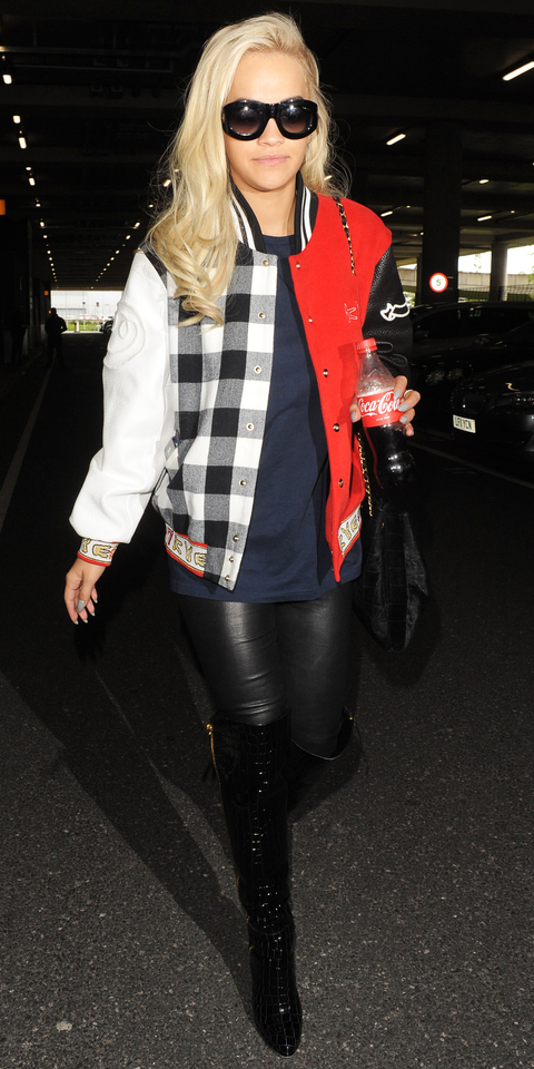 Rita Ora at Heathrow Airport - Slide