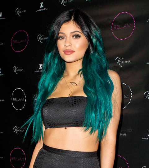 Kylie Jenner poses happily with her sisters Kim and Khloe on her big hair line extension night launch party in Los Angeles. Kylie was promoting her 'Kylie Hair Kouture' brand at a salon where her famous family joined her as well as cast members from the h