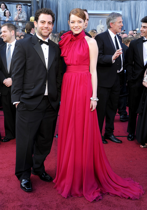 Actress Emma Stone (R) and brother Spencer Stone arrive at the 84th Annual Academy Awards at Hollywood & Highland Center on February 26, 2012 in Hollywood, California.