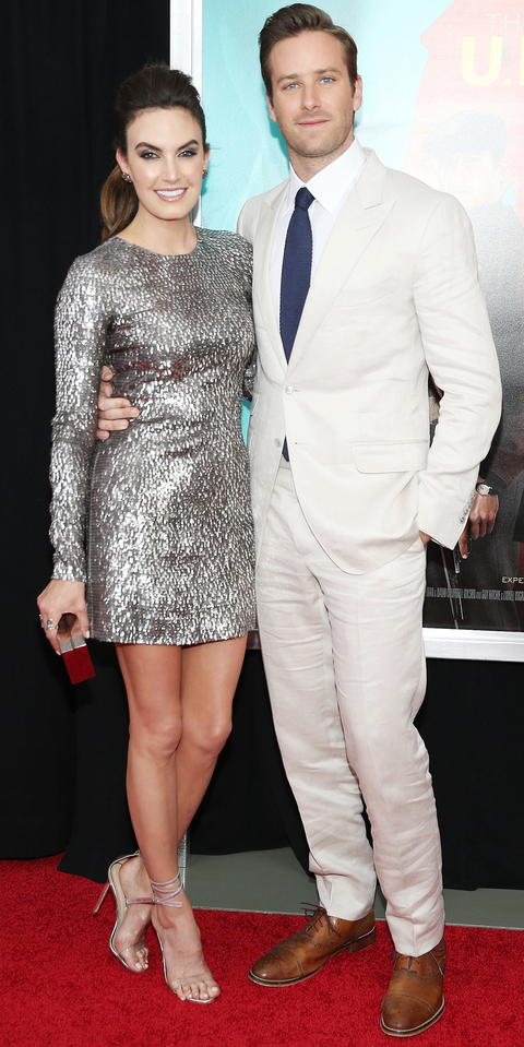 Actors Elizabeth Chambers and Armie Hammer attend the New York premiere of 'The Man From U.N.C.L.E.' at Ziegfeld Theater on August 10, 2015 in New York City.