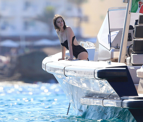 Actors Anne Hathaway shows off her bikini body as she and Adam Shulman vacation in Ibiza, Spain on August 13, 2015. The pair took a swim in the ocean with pals and showed off their playful side when Adam sprayed Anne with a water hose!