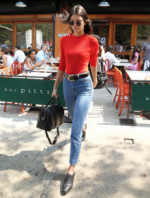 Model Kendall Jenner, wearing jeans and orange top, eats lunch at Bar Pitti in New York City