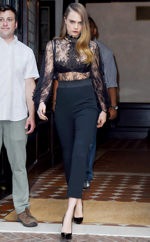 Cara Delevingne leaves her hotel looking runway fierce in a sheer top