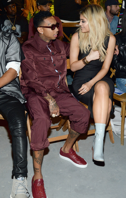 Tyga (L) and Kylie Jenner attend the Opening Ceremony Spring 2016 fashion show during New York Fashion Week at 25 Wall Street on September 13, 2015 in New York City.