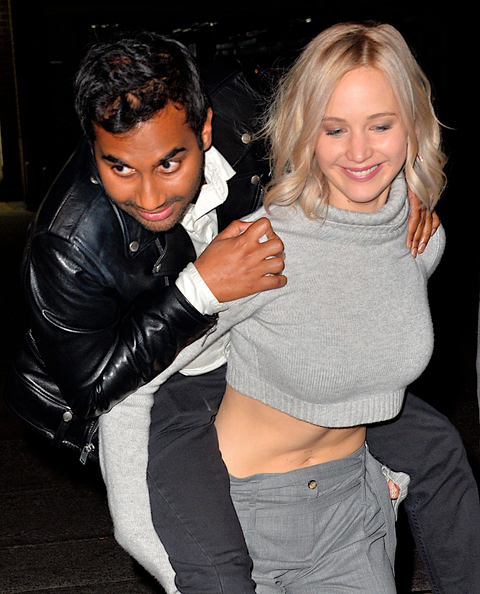 Jennifer Lawrence gives Aziz Ansari a piggyback ride