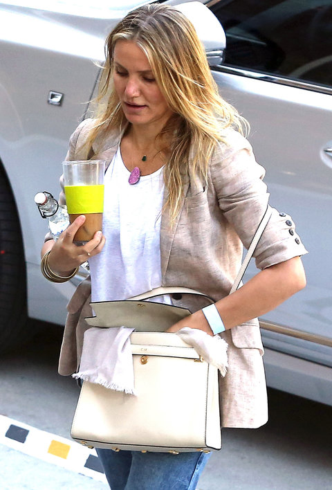 """November 8, 2015: Cameron Diaz arriving at Universal Studios in Los Angeles, California. Diaz is seen carrying a handbag with the initials of her married name, Cameron Madden, or """"C.M."""""""