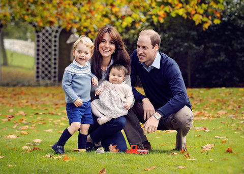This undated handout image provided by Kensington Palace on December 18, 2015 shows Prince William, Duke of Cambridge and Catherine, Duchess of Cambridge with their children, Prince George and Princess Charlotte, in a photograph taken late October at Kens