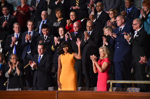 First Lady Michelle Obama before US President Barack Obama delivers his State of the Union address before a joint session of Congress on January 12, 2016 at the US Capitol in Washington, DC.