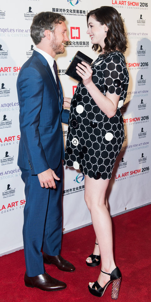Actress Anne Hathaway and husband Adam Shulman arrive at LA Art Show And Los Angeles Fine Art Show's 2016 Opening Night Premiere Party Benefiting St. Jude Children's Research Hospitalat Los Angeles Convention Center on January 27, 2016 in Los Angeles, Cal