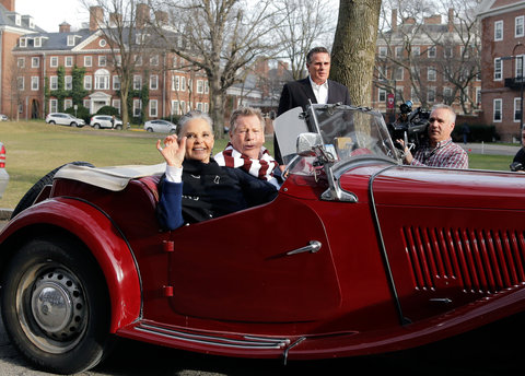 """Actors Ali MacGraw, left, and Ryan O'Neal drive up in an antique MG convertible on the campus of Harvard University in Cambridge, Mass., Monday Feb. 1, 2016, more than 45 years after the release of their 1970 classic """"Love Story."""" The duo, now in their 70"""