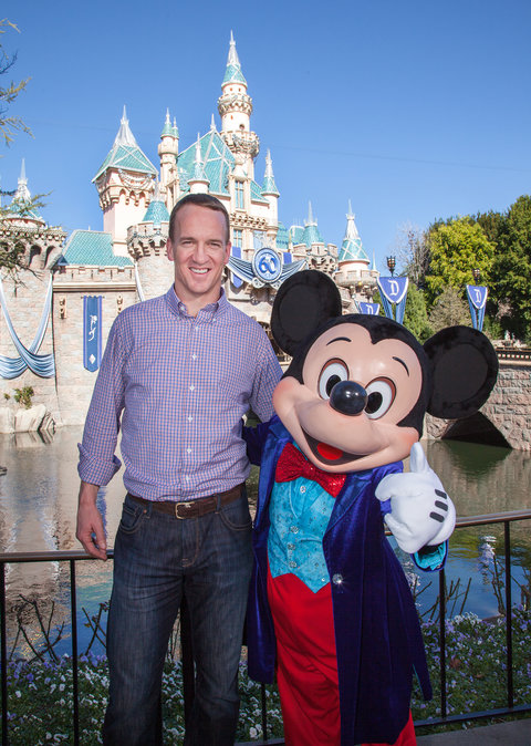 In this handout photo provided by Disney Parks, Mickey Mouse greets Denver Broncos quarterback Peyton Manning at Sleeping Beauty Castle at Disneyland park in Anaheim, Calif., on Monday February 8, 2016. In honor of the Denver Broncos' victory at Super Bow
