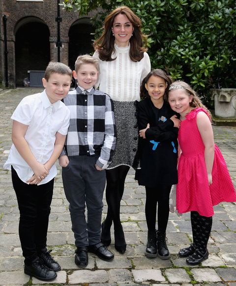 Kate Middleton in Sheer Blouse and Tweed Skirt