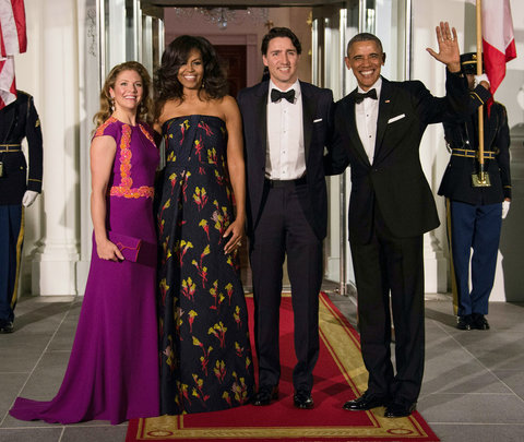 US President Barack Obama (R), Canadian Prime Minister Justin Trudeau (2nd R) and their wives Michelle Obama (2nd L) and Sophie Gregoire Trudeau (L) pose u[pon the Trudeau's arrival for a State Dinner in their honor at the White House in Washington, DC, o