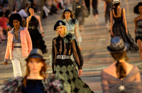 Models wear creations from the Karl Lagerfeld  cruise  line for fashion house Chanel, at the Paseo del Prado street in Havana, Cuba, Tuesday, May 3, 2016. With the heart of the Cuban capital effectively privatized by an international corporation under the