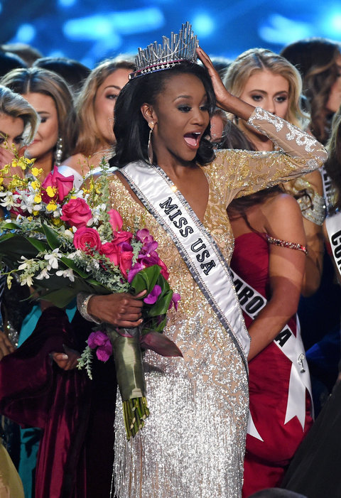 Miss District of Columbia USA 2016 Deshauna Barber is surrounded by fellow contestants after being crowned Miss USA 2016 during the 2016 Miss USA pageant at T-Mobile Arena on June 5, 2016 in Las Vegas, Nevada.