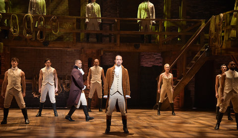 Actor Leslie Odom, Jr. (L) and actor, composer Lin-Manuel Miranda (R) and cast of 'Hamilton' perform on stage during 'Hamilton' GRAMMY performance for The 58th GRAMMY Awards at Richard Rodgers Theater on February 15, 2016 in New York City.