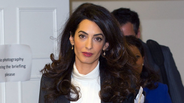 Amal Clooney Wears Pinstripe Suit In London Instyle Com