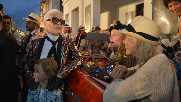German fashion designer, artist, and photographer Karl Lagerfeld (L) attends his performance for Chanel at the Prado promenade in Havana, on May 3, 2016.