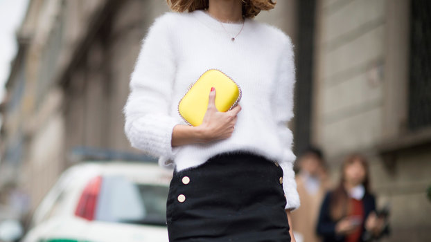 MILAN, ITALY - FEBRUARY 25:  A guest is wearing a yellow clutch  seen in the streets of Milan during the Milan Fashion Week Fall/Winter 2016/17 on February 25, 2016 in Milan, Italy.  (Photo by Timur Emek/Getty Images)