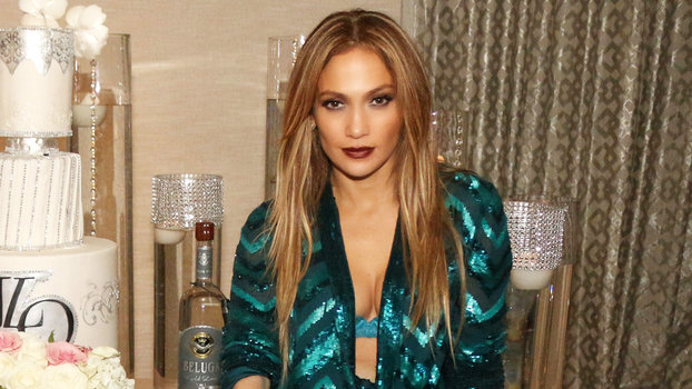 7d3c82d0514 Birthday Girl Jennifer Lopez Flaunts Her Assets in a Plunging Green Jumpsuit