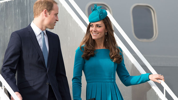 Britain's Prince William (L) with Catherine the Duchess of Cambridge walk from the plane after arriving in Dunedin  airport in Dunedin on April 13, 2014. William, Kate and their son Prince George are on a three-week tour of New Zealand and Australia.  AFP