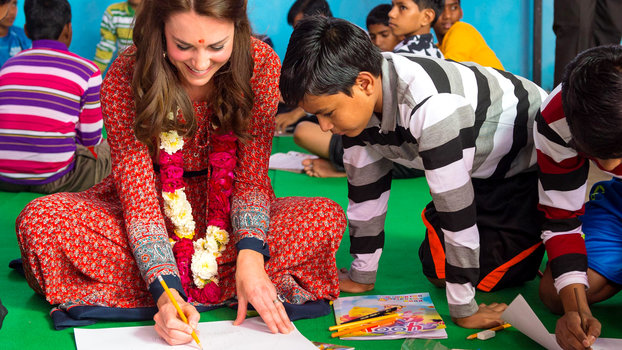 NEW DELHI, INDIA - APRIL 12:  Catherine, Duchess of Cambridge particpates in an arts class with street children at a contact centre run by the charity Salaam Baalak, which provides emergency help and long term support to homeless children at New Delhi rai