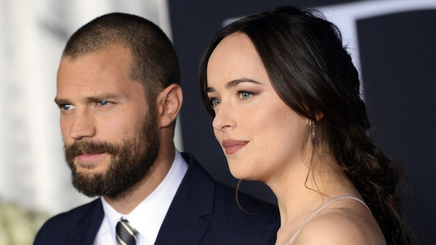 """LOS ANGELES, CA - FEBRUARY 02:  Actor Jamie Dornan and actress Dakota Johnson  arrive for the Premiere Of Universal Pictures' """"Fifty Shades Darker"""" at The Theatre at Ace Hotel on February 2, 2017 in Los Angeles, California.  (Photo by Albert L. Ortega/Get"""