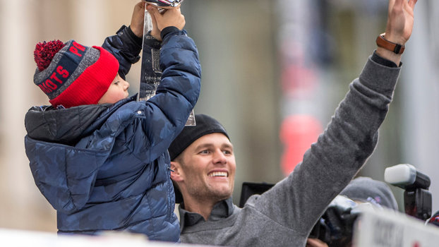BOSTON, MA - FEBRUARY 07: Tom Brady of the New England Patriots reacts with his son Benjamin during the Super Bowl victory parade on February 7, 2017 in Boston, Massachusetts. The Patriots defeated the Atlanta Falcons 34-28 in overtime in Super Bowl 51. (