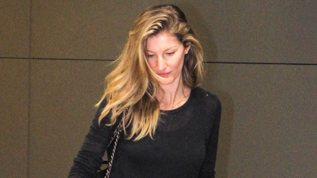 *EXCLUSIVE* Sao Paulo, SP - Gisele Bundchen is not in the mood for pictures as she makes her way thru Guarulhos Airport in Sao Paulo, Brazil.    AKM-GSI           February 6, 2015