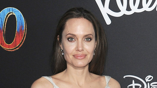 InStyle's Look of the Day picks for March 12, 2019 include Angelina Jolie, Kate Middleton and Meghan Markle.
