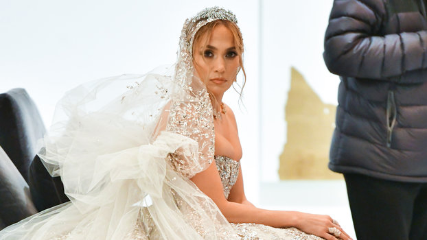 Jennifer Lopez wearing a wedding dress on the set of Marry Me