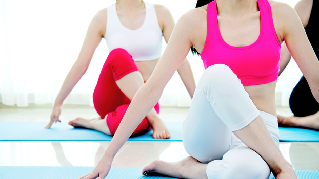 Young women doing stretching exercises