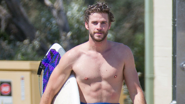 Liam Hemsworth Spotted Surfing In Australia Instyle Com