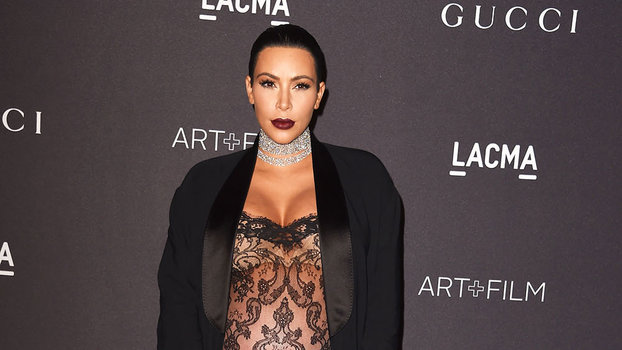 Kim Kardashian Rocks A Very Sheer Lace Jumpsuit While Many Months