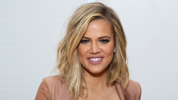 Khloe Kardashian Half Up Bun Photo Instyle Com