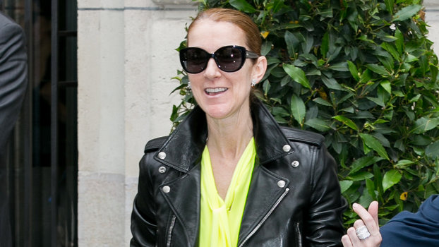 celine dion wears leather jacket and neon dress in paris