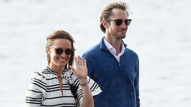 Pippa Middleton (L) and her husband James Matthews (R) arrive at Rose Bay Wharf by sea plane in Sydney on May 31, 2017. Pippa and Matthews, who married on May 20, 2017, are visiting Sydney on their honeymoon.