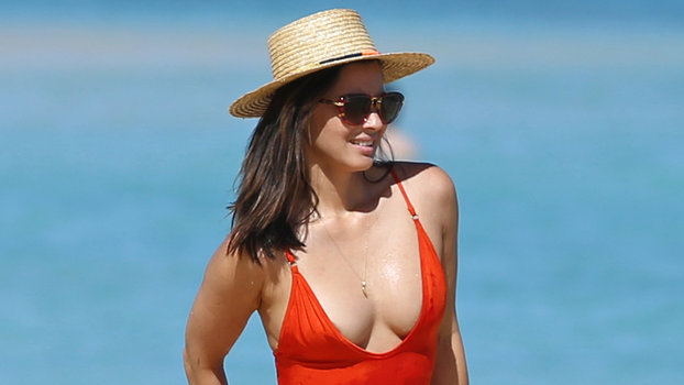 e392c832897 Olivia Munn Wears a Red Hot Swimsuit in December   InStyle.com