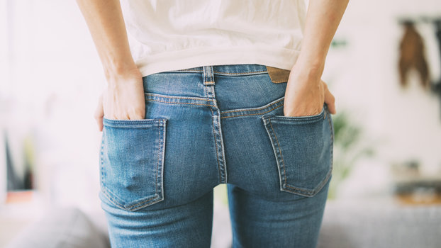Rear view of young woman wearing jeans