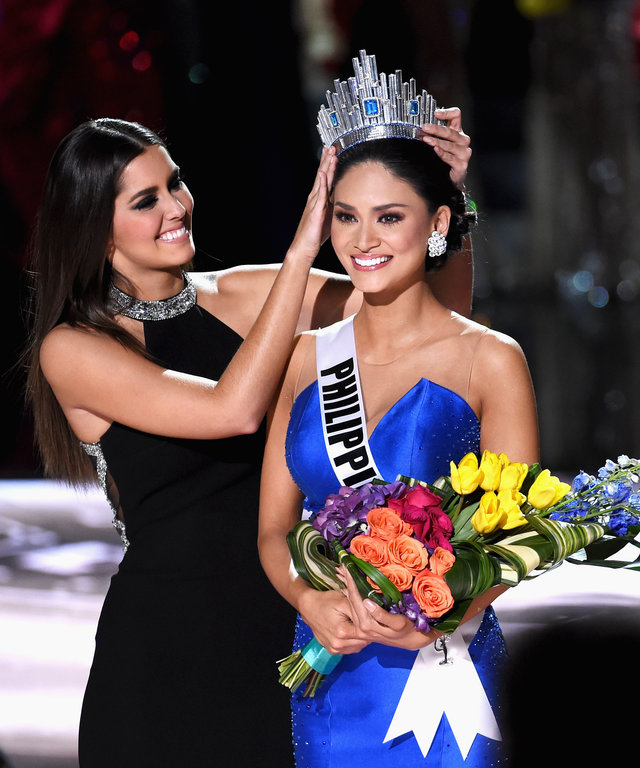 Miss Philippines 2015, Pia Alonzo Wurtzbach (R), reacts as she is crowned the 2015 Miss Universe by Miss Universe 2014 Paulina Vega (L) during the 2015 Miss Universe Pageant at The Axis at Planet Hollywood Resort & Casino on December 20, 2015 in Las Vegas