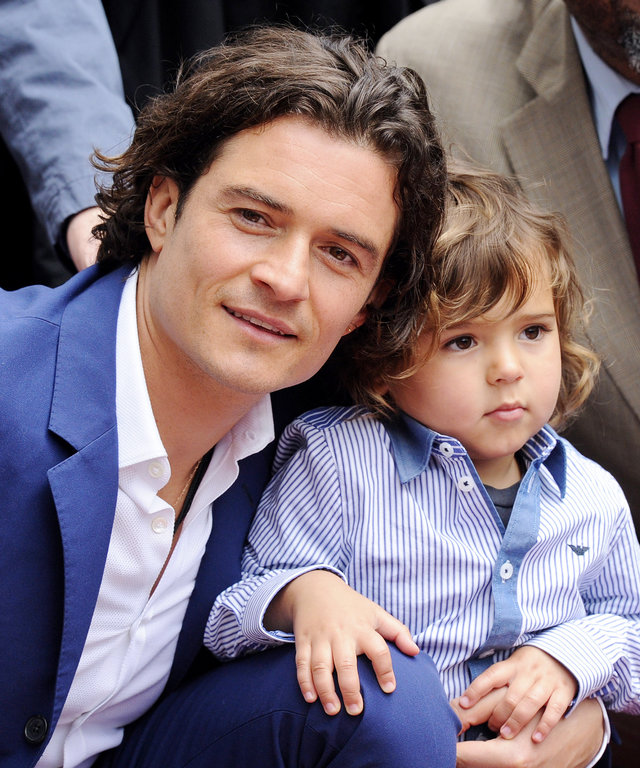 HOLLYWOOD, CA - APRIL 02:  Actor Orlando Bloom and his son Flynn Bloom attend the ceremony honoring Orlando Bloom with a Star on The Hollywood Walk of Fame on April 2, 2014 in Hollywood, California.  (Photo by Axelle/Bauer-Griffin/FilmMagic)