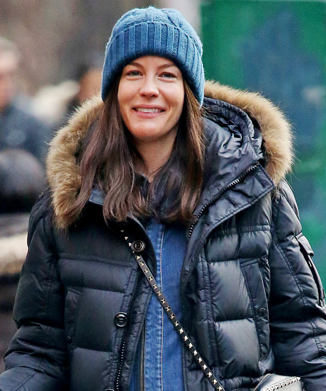 EXCLUSIVE: Liv Tyler displays her growing baby bump in a denim one-piece as she strolls through the west village, NYC