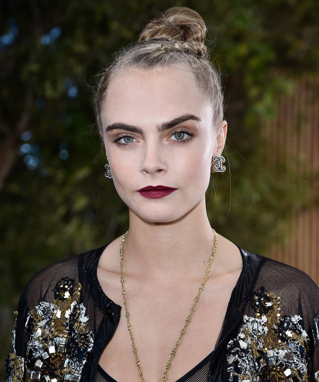 Cara Delevingne attends the Chanel Spring Summer 2016 show as part of Paris Fashion Week on January 26, 2016 in Paris, France.