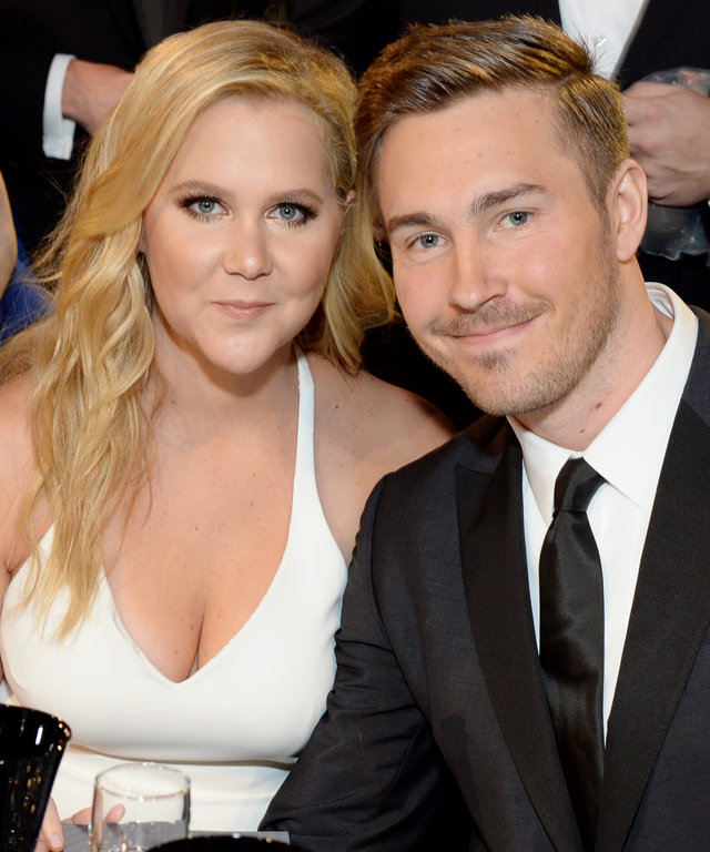 SANTA MONICA, CA - JANUARY 17:  Honoree Amy Schumer (L) and designer Ben Hanisch attend the 21st Annual Critics' Choice Awards at Barker Hangar on January 17, 2016 in Santa Monica, California.  (Photo by Michael Kovac/Getty Images for Moet & Chandon)