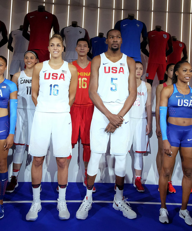 Athletes from various countries and sports pose wearing new jersey and footwear made by Nike during an unveiling event in New York on March 17, 2016.