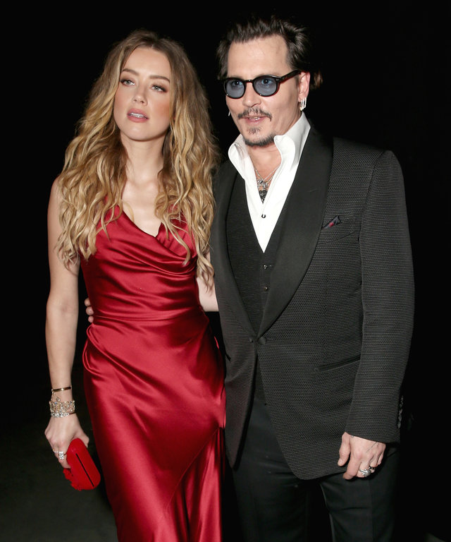 CULVER CITY, CA - JANUARY 09:  Actors Amber Heard (L) and Johnny Depp attend The Art of Elysium 2016 HEAVEN Gala presented by Vivienne Westwood & Andreas Kronthaler at 3LABS on January 9, 2016 in Culver City, California.  (Photo by Todd Williamson/Getty I