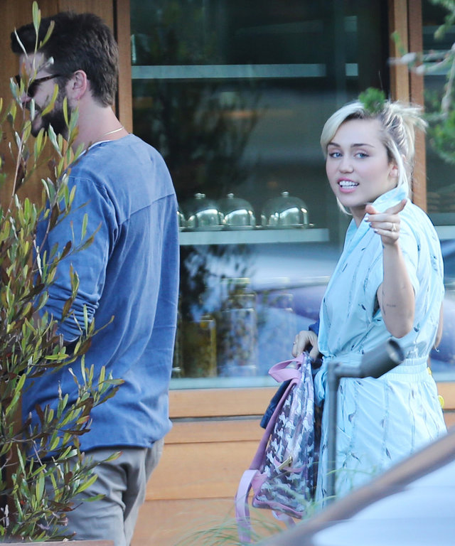 Miley Cyrus and Liam Hemsworth arrive to Soho House to celebrate their 4th of July weekend with friends.