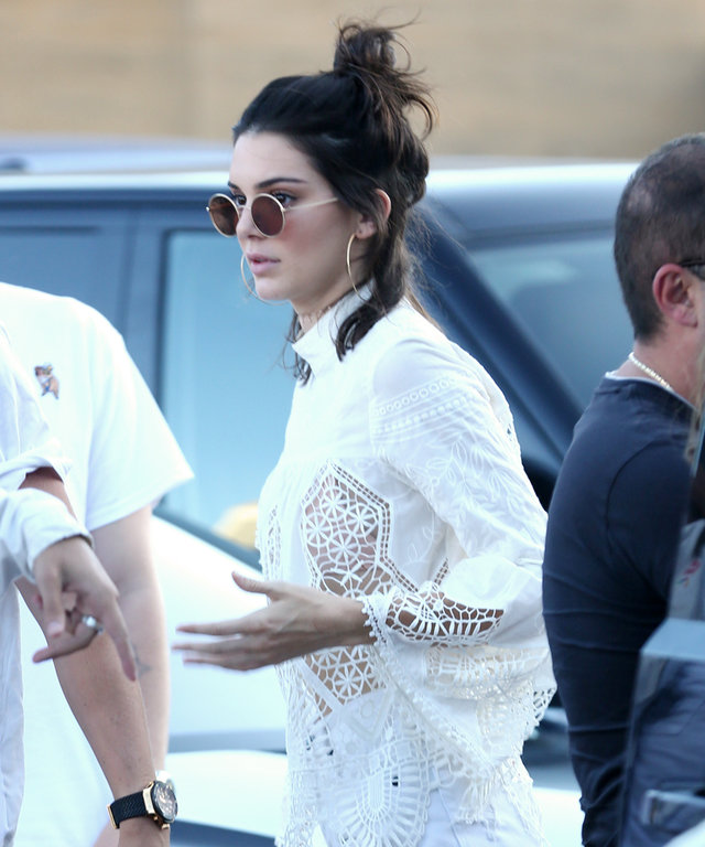 Malibu, CA - It girl Kendall Jenner arrives to Nobu to celebrate Independence Day with her friends. The young model is wearing white denim shorts paired with a sheer lace top and sneakers.