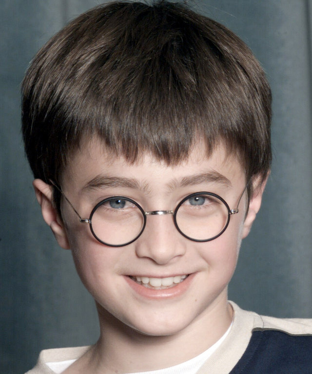 "LONDON - AUGUST 23: Actor Daniel Radcliffe attends a press conference for the movie ""Harry Potter and The Philosopher's Stone"" in London on August 23, 2000. 11 year old Daniel will play Harry Potter in the film of the popular book by JK Rowling. (Photo by"
